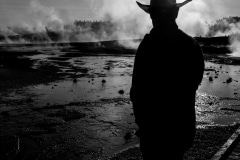 cowboy watching rising steam, Yellowstone